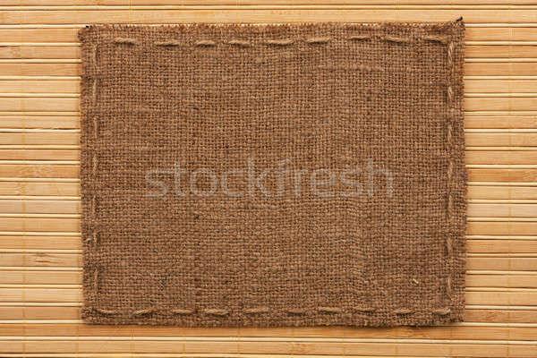 Frame of burlap, lies on a background of  bamboo mat Stock photo © alekleks