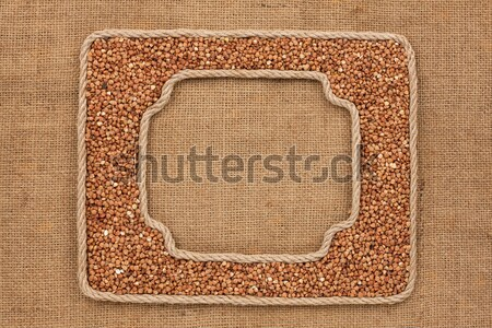 Two frames made of the rope with buckwheat  grain on a white bac Stock photo © alekleks