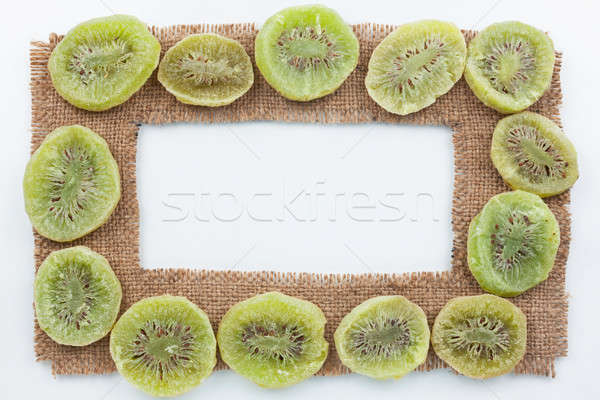 Frame made of burlap with dried kiwi Stock photo © alekleks