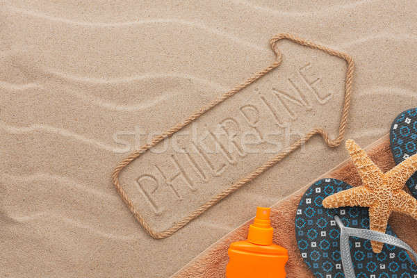 Philippines pointer and beach accessories lying on the sand Stock photo © alekleks