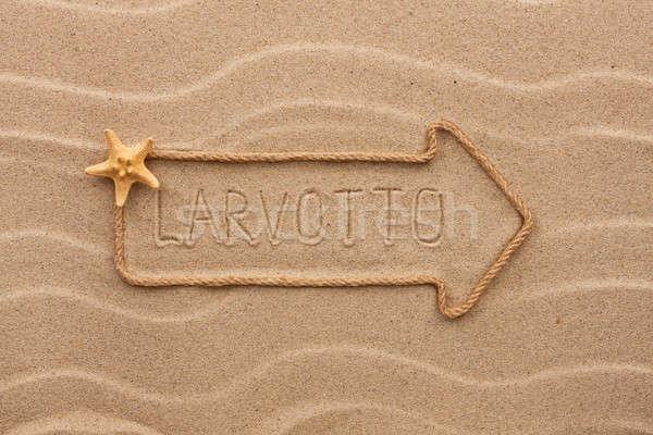 Arrow made of rope and starfish with the word Larvotto on the sa Stock photo © alekleks