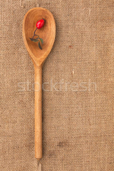 Wooden spoon with rosehip lying on sackcloth Stock photo © alekleks