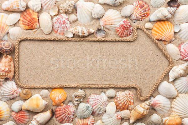 Pointer made of rope with seashells Stock photo © alekleks
