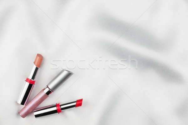 Beautiful picture of cosmetic  on white satin Stock photo © alekleks