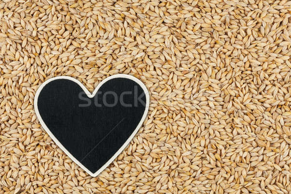 Heart pointer, the price tag lies on grains barley Stock photo © alekleks