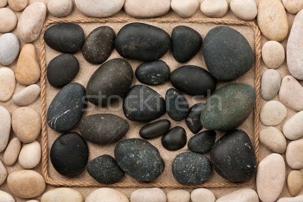 Beautiful frame made of rope with black and white  stones on the Stock photo © alekleks