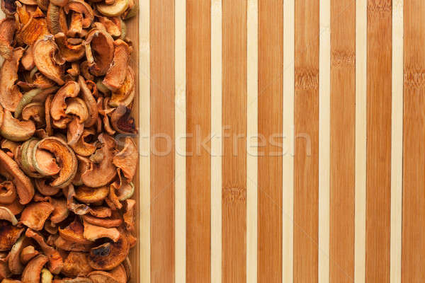Dried apples on a bamboo mat Stock photo © alekleks