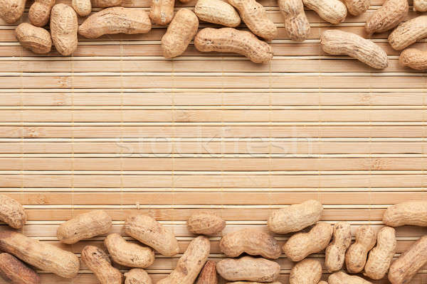 Peanut  lies on the a bamboo mat Stock photo © alekleks