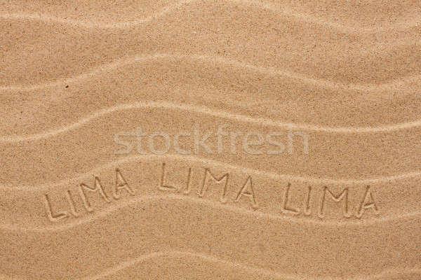 Lima inscription on the wavy sand Stock photo © alekleks
