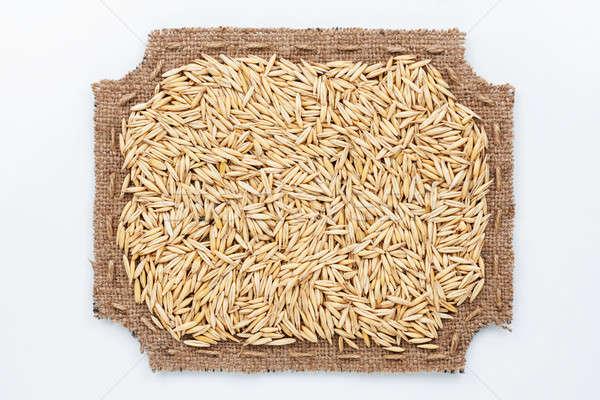 Figured frame made of burlap and  oats  grains Stock photo © alekleks