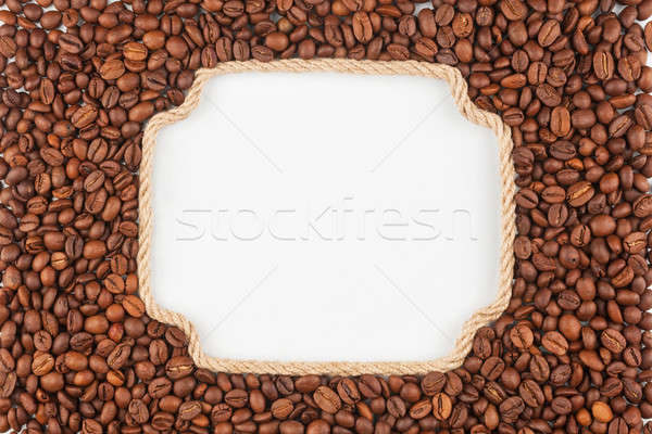 Figured frame  made of rope with  coffee beans  lying on a white Stock photo © alekleks