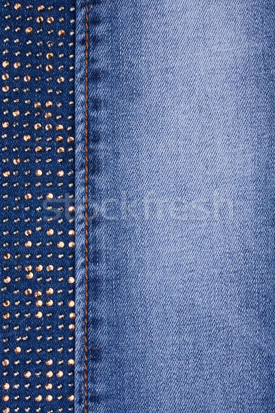 Yellow rhinestones and yellow seam on denim Stock photo © alekleks