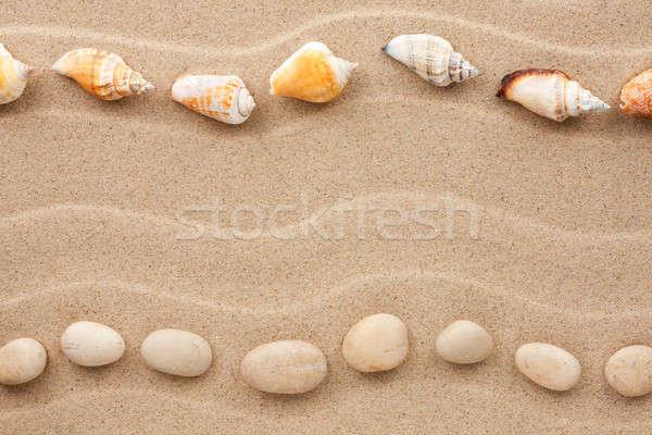 Dois pedras conchas areia espaço Foto stock © alekleks