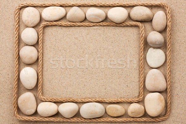 Beautiful frame with rope and white stones on sand Stock photo © alekleks