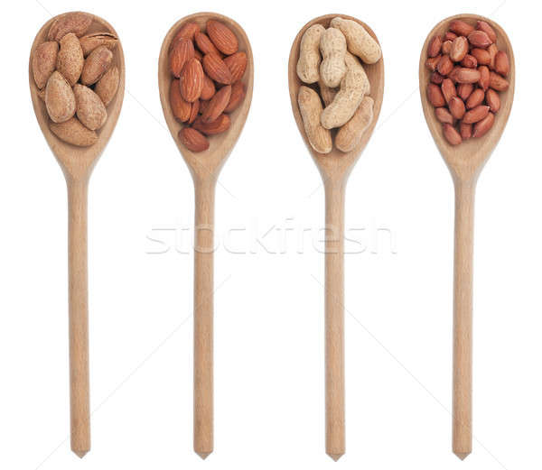 Peeled and unpeeled almonds and peanuts in a wooden spoon Stock photo © alekleks
