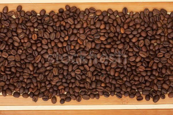 Coffee beans lying on a bamboo mat Stock photo © alekleks