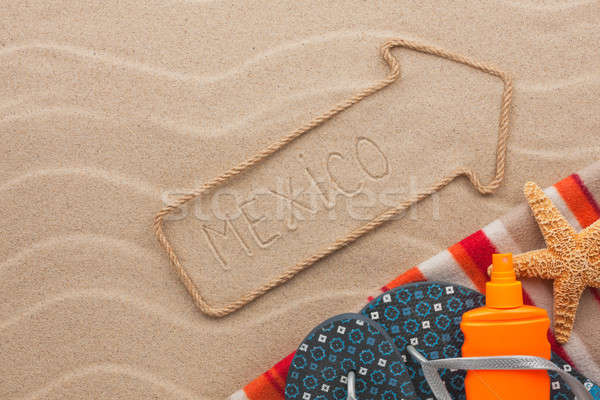 Mexico pointer and beach accessories lying on the sand Stock photo © alekleks