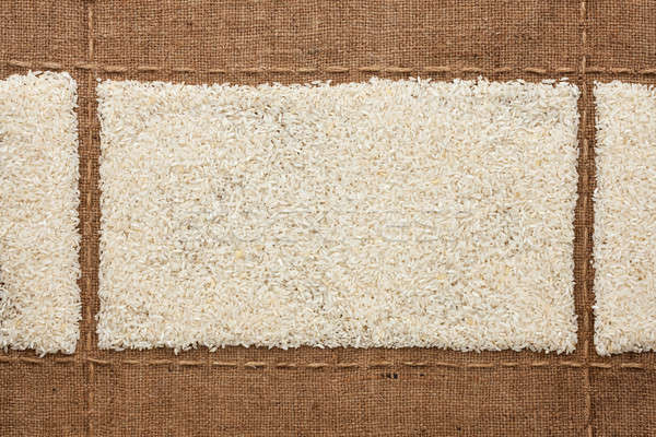 Rice grains on sackcloth, with place for your text Stock photo © alekleks
