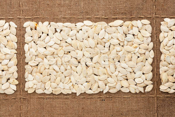 Pumpkin seeds on sackcloth, with place for your text Stock photo © alekleks
