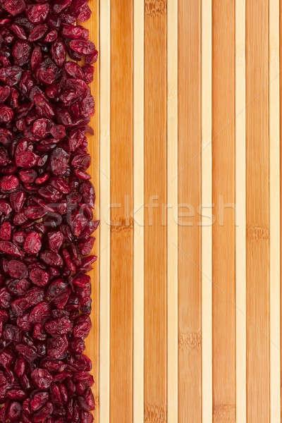 Dried cranberries lying on a bamboo mat  Stock photo © alekleks