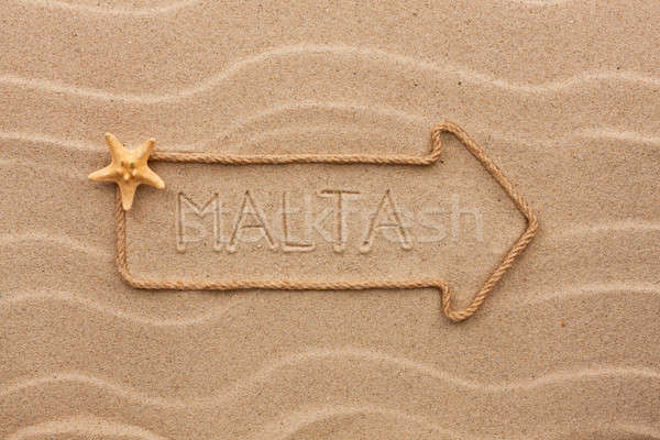 Arrow made of rope and starfish with the word Malta on the sand Stock photo © alekleks