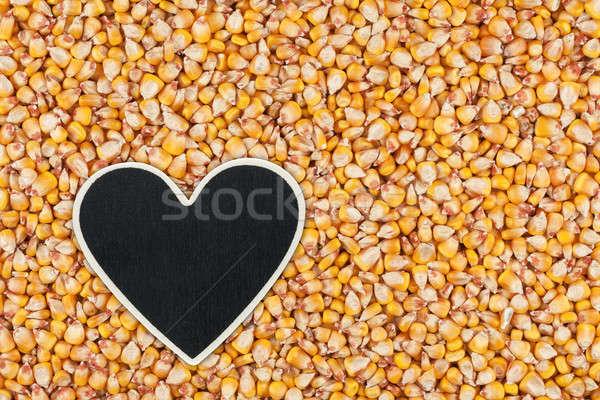Heart pointer, the price tag lies on grains corn Stock photo © alekleks