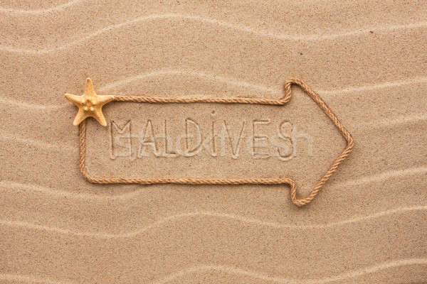 Arrow made of rope and sea shells with the word Maldives on the  Stock photo © alekleks