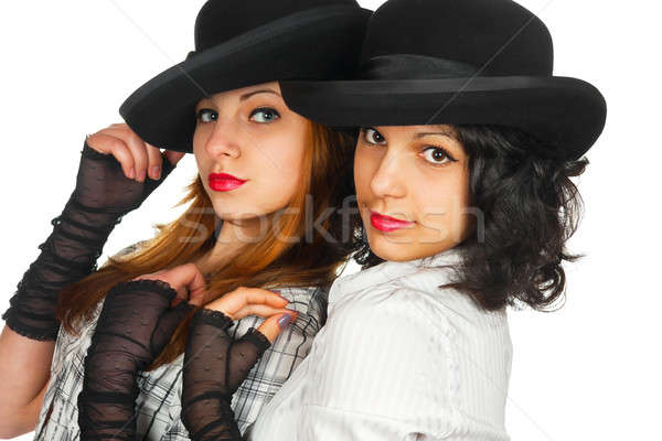 Two girls in hats and gloves Stock photo © alekleks