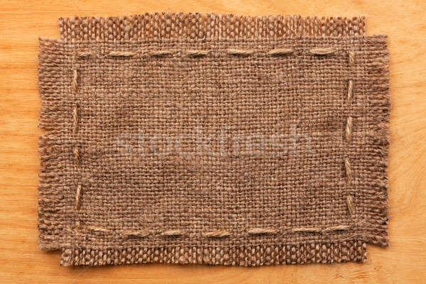 Frame of burlap, lies on a background of wood Stock photo © alekleks
