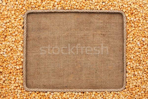 Frame made of rope with  peas  grains on sackcloth Stock photo © alekleks