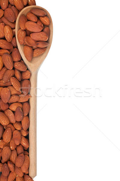 Stock photo: Wooden spoon with almonds
