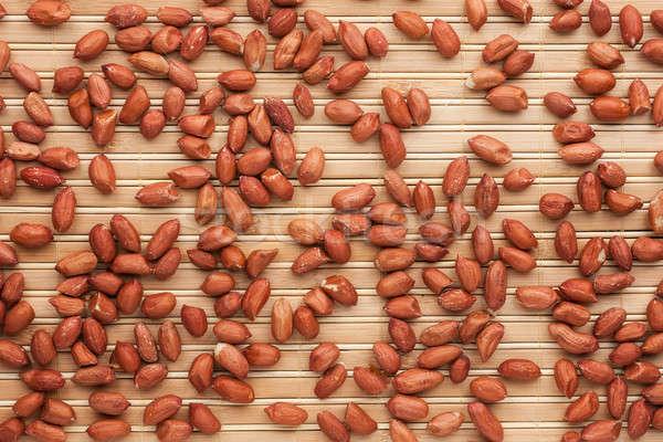Stock photo: Peanut  lying on a bamboo mat