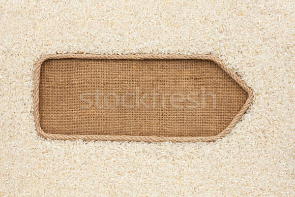 Pointer made from rope with grains rice lying on sackcloth Stock photo © alekleks