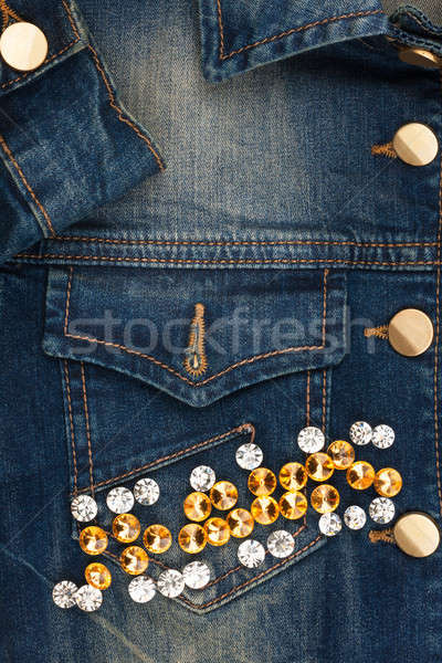 Word jeans made of rhinestones on denim jacket Stock photo © alekleks