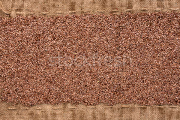 Flax seeds lying on sackcloth between the lines Stock photo © alekleks