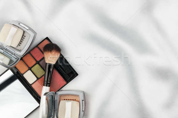 Beautiful picture of cosmetic on white silk Stock photo © alekleks