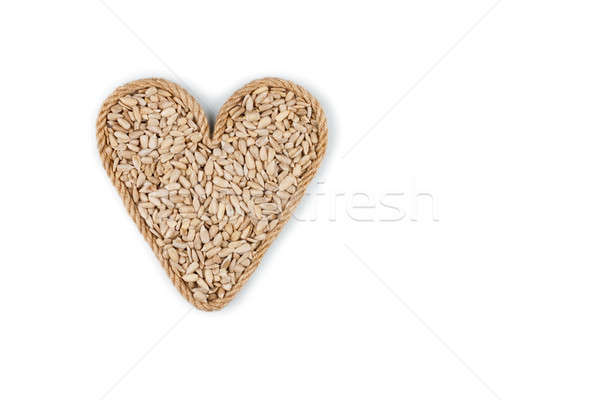 Symbolic heart made from rope with sunflower seeds  Stock photo © alekleks