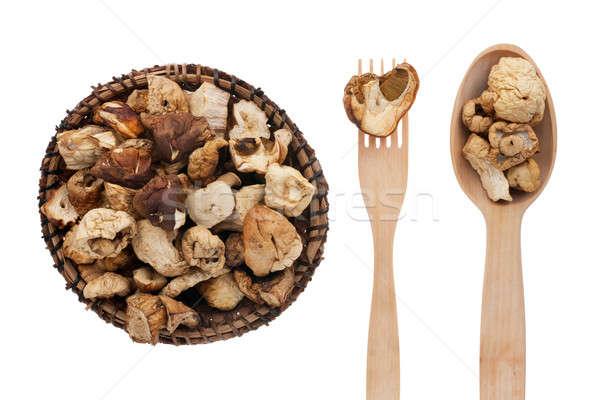 Dried mushroom in a plate, fork and spoon Stock photo © alekleks