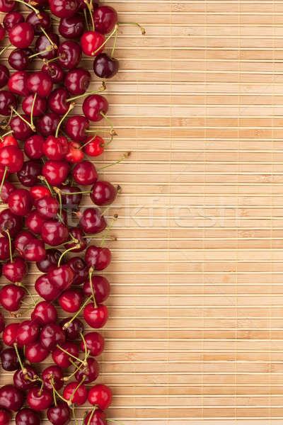 Cherry lying on bamboo mat Stock photo © alekleks