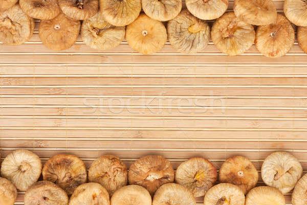 Dried figs lying on a bamboo mat Stock photo © alekleks