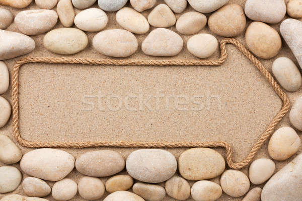 Pointer made of rope with white stones Stock photo © alekleks
