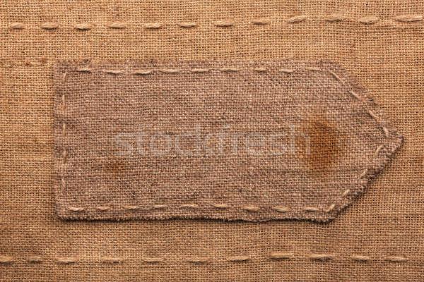 Arrow made of burlap  lies on a sacking  background Stock photo © alekleks
