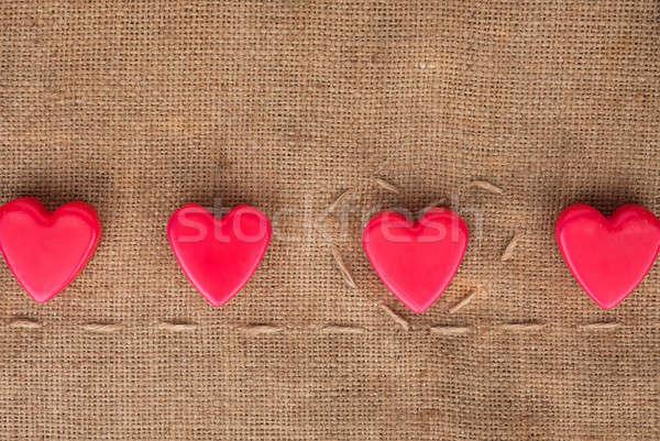 Five  hearts on sackcloth Stock photo © alekleks