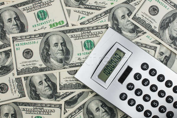 Calculator lies on a million dollars Stock photo © alekleks