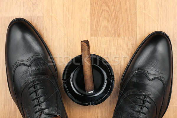 Classic men's shoes, ashtray and  fuming cigar on the wooden flo Stock photo © alekleks