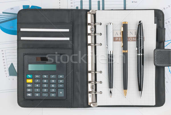 Diary, calculator and three pen lying on a background of diagram Stock photo © alekleks