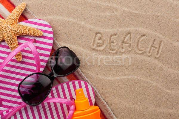 Word beach, written in the sand Stock photo © alekleks