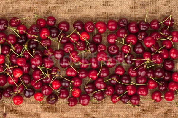 Cherry lies on sackcloth Stock photo © alekleks
