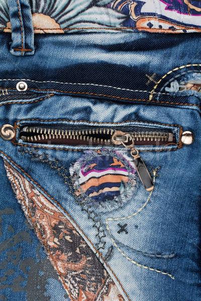Pocket light blue jeans with zipper Stock photo © alekleks