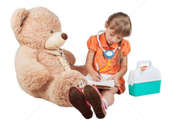 Baby is playing doctor, treats a bear Stock photo © alekleks